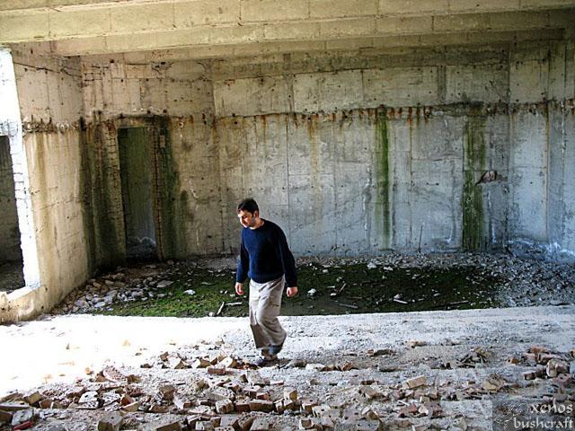 Една от бъдещите амфитеатрални аудитории. Строителни отпадъци, пепел и... малко езерце.